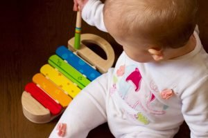 Baby with toy glockenspiel
